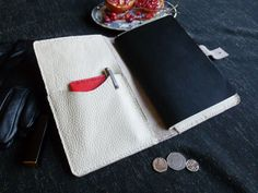 £35.40  Notebook or Moleskine Cover: chic and stylish home for projects, thoughts and musings. This soft white cover is build to last and has a large inside pocket on the left side with a smaller pocket for a mobile phone or similar. https://www.etsy.com/uk/listing/480017174/white-leather-journal-cover-moleskine?ref=shop_home_active_5 White Leather Journal Cover, Moleskine, Notebook, Field Notes, Diary, Travel Journal, White, Chic, Gift For Her, Recipes notes, Organiser.