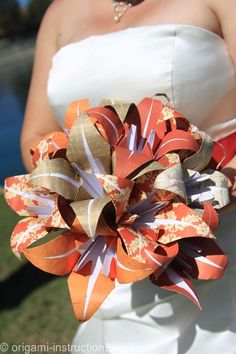 Bride carrying bouquet of origami lilies on her wedding day