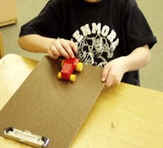 Force and motion kindergarten study - use clipboards with different paper surfaces