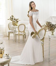 Beautiful classic styled wedding dress off the shoulder design