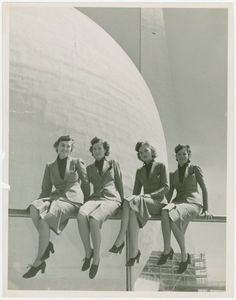 1939 New York World's Fair - United Airlines Airline Hostesses with Perisphere in background.