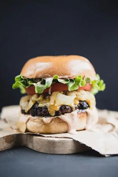 A perfectly soft bun, quality, juicy meat that is seasoned well, plenty of cheese, caramelized onions and a really good secret sauce are the key to making a truly classic cheeseburger at home.