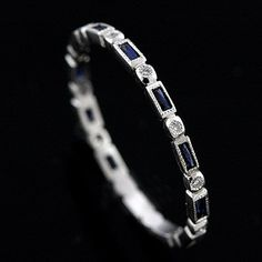 Petite and pretty platinum Art Deco style Diamond and Blue Sapphire by OroSpot