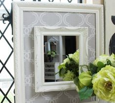 Add an elegant fabric frame to boring mirrors Highlight mirrors and other wall decor by surrounding them in fabric