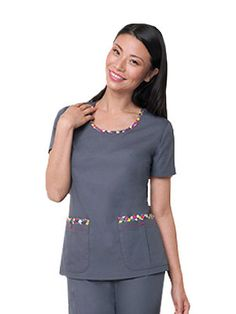 This fun round neck scrub top features contrast zig zag stitching at the neck and pocket hem line! Scrubs Outfit, Scrubs Uniform, Stylish Scrubs, Medical Uniforms, Uniform Design, Medical Scrubs, Nursing Clothes, African Men Fashion, Scrub Tops