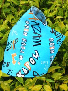 Reversible Bandana Bib with superhero quotes on bright blue cotton on outer, and blue check inner