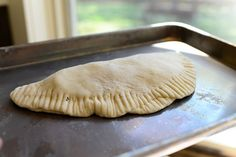 Pioneer Woman's easy pizza pocket / calzone recipe using frozen dinner rolls