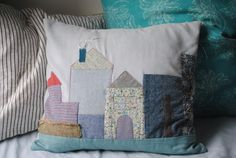 Quilted pillow baby gift made from fabric scraps on Eclectic Mom.