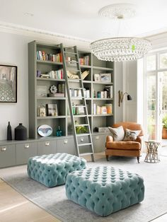 Reading nook located next to a window with the mix of a modern sconce with a vintage chair