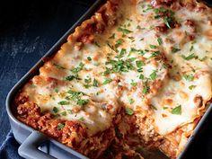 Ingredients    2 lbs ground beef  1 medium onion, chopped  3 cloves garlic, chopped  1 Tbsp olive oil  2 15 oz cans tomato sauce  1 15 oz can water  1 12 oz can tomato paste  1 tsp oregano  1 tsp basil  16 oz mozzarella cheese, grated  16