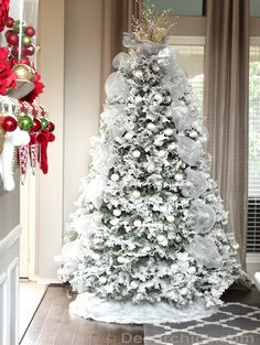 I love the silver tulle/mesh going down the tree. . perhaps an idea for mine next year?