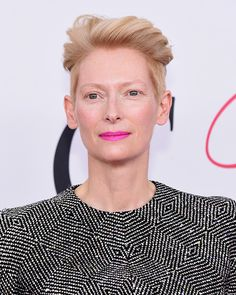 2016 CFDA Awards: Tilda Swinton kept things cool, literally, with her blue-based pink lipstick and icy blonde hair.  | allure.com