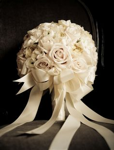 All white bride bouquet with white ribbon. #flowers #wedding #bouquet