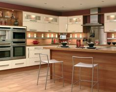 photo of calm modern natural romantic cream premier kitchens kitchen kitchen/diner with wooden worktop worktop and stainless steel extractor...