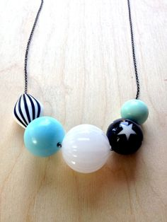 Love the star bead and these gorgeous blues. :: A soul juice necklace by Kelly Barton