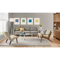 gray chair, wooden hutch, standing lamp, artwork, window no on couch, loveseat, coffee table