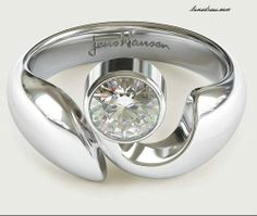 I would like to see a matching wedder for this unusual engagement ring. I think it's lovely. :)