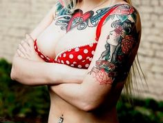 Tattooed girl - chest piece, tattoo on the shoulder and one on the arm. #tattoo #tattoos #ink #inked