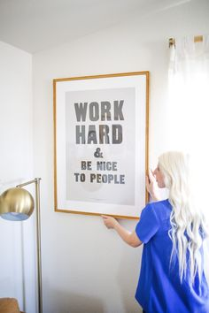 """Work Hard & Be Nice To People"" poster print by Anthony Burrill in our gold Richmond frame with a white mat."