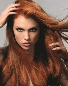 Pretty much my hair color except my hairs wavy and medium length.
