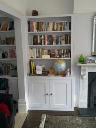 Alcove fitted cupboards and bookshelves design ideas. Explore our range of bespoke built-in cabinets, bookcases, floating shelves and other fitted furniture Alcove Bookshelves, Alcove Cupboards, Built In Cupboards, Room Shelves, Bookcases, Chimney Breast Shelving, Alcove Storage Living Room, Shelves Around Fireplace, Bungalow Interiors