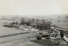 Anonymous | Uitzicht vanaf watertoren, Anonymous, 1940 | UItzicht vanaf een watertoren over boerderijen en weilanden. Achterop staat: Blick v. Wasserturm Dongen in Richtung Breda.