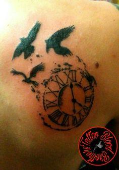 Reloj y pájaros