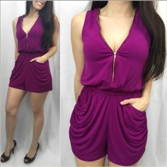 "PURPLE FUCHSIA ZIPPERED RUCHED ROMPER This adorable purple/fuchsia romper is perfect for spring/summer. It is so flattering on! Features a functioning gold tone zipper on the front and back so you control the coverage. Has ruched functional pockets and elastic comfort waistband. So comfortable!!! Fits true to size. Apprx 32.5"". 95% poly, 5% spandex. S(2-4) M(6-8) L(10-12) model is 5'2"" 115 lbs and wearing size small. Price is firm unless bundled. MEGA FAST SHIPPER! Also have in orangey/red…"