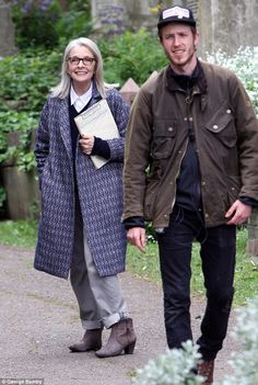 Eternal: The Oscar-winning actress looked much younger than her years as she opted for a black jumper over a crisp white button down top underneath the statement outerwear