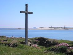 The view of the Cross on St Cuthbert's Isle - Photo: by Sandy Gemmill. *Just off-shore from Holy Island [Lindisfarne] village, is the small Island of Hobthrush, or St Cuthbert's Isle. There are the remains of a small medieval chapel on St Cuthbert's Isle, a small island, which is completely cut from Holy Island when there is a high tide. .