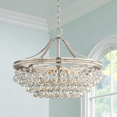 A shimmering five-light pendant with an array of clear crystal accents and a brushed nickel frame.