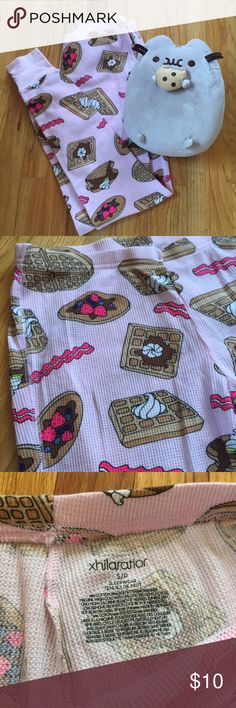 NWOT Breakfast Thermal Pajama Pants 🥞🥓🍳😍 OFFERS WELCOMED😊💕 NWOT (new without tags) fun light pink breakfast design thermal pajama pj pants with pancakes, waffles, and bacon! 🥞🥓 Perfect for a sleepover! Never worn before! (Too big for me!) No trades, please! ✨20% OFF 2+ ITEM BUNDLE✨ (Pusheen not included 😄) Xhilaration Intimates & Sleepwear Pajamas
