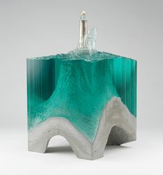 Lonesome Light, Laminated clear float glass with cast concrete base and cast white bronze lighthouse - Ben young sculptures