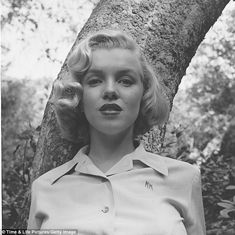 LIFE photographer Ed Clark shot the actress in Griffith Park, Los Angeles in August 1950. She wore a light-colored shirt upon which is embroidered the letters 'MM'