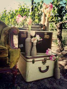Vintage Photo Shoot-Vintage Suitcases, repurposing bottles with vintage measuring tape & twine. Suitcases,Tulips,Typewriter's in the Vines! www.MadamPaloozaEmporium.com www.facebook.com/MadamPalooza