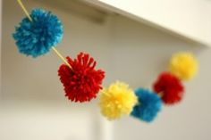 yarn pom pom garland - think these would be fun hanging up around the house!
