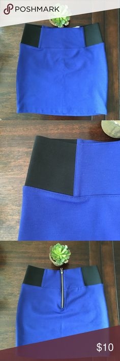 Blue high waisted skirt with black waist detail Sexy Blue bandage skirt with black elastic waist detail and zip up back. Gently used. Charlotte Russe Skirts Mini