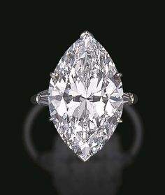 "A HIGHLY IMPORTANT SINGLE-STONE DIAMOND RING, BY HARRY WINSTON  Set with a marquise-cut diamond, weighing approximately 17.80 carats, flanked on either side by tapered baguette-cut diamonds, mounted in platinum, (inscribed ""17.80"") Signed Winston for Harry Winston"