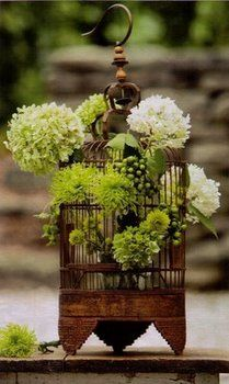 If I had the money to buy lots of birdcages, this could be very pretty centerpiece (in our colors of course).
