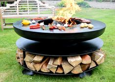 Promoting al fresco dining at its finest, the Ring of Logs 120 BBQ Ring has a large outer area for cooking on. The style and size of this design lends itself to entertaining with independent cooking providing a social atmosphere. With a good fire burning, Indoor Outdoor Fireplaces, Outdoor Fireplace Designs, Fire Pit Grill, Fire Pit Backyard, Backyard Patio Designs, Backyard Landscaping, Barbecue Design, Cool Fire Pits, Bbq Area