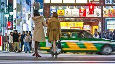 Tokyo, Japan - March 15, 2015: People waiting the traffic lights at Shinjuku Kabukicho in the night.