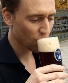 Tom Hiddleston | Even sexy while drinking a beer.