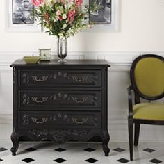 "Via HD ""Have an antique sideboard, desk, dresser or table that needs refinishing? A coat of matte or high-gloss black paint could be just what it needs to fit into a more contemporary space."""