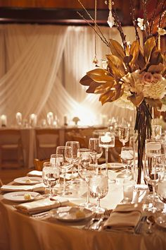 elegant gold winter wedding // tall centerpieces with gold and white floral accents