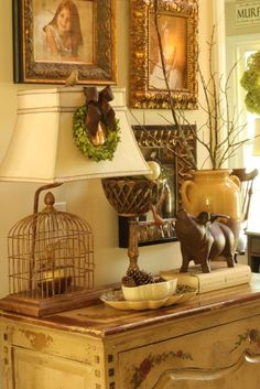 Birdcage lamp and simple pinecones in cream colored ceramic