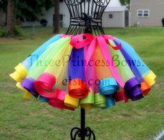 Interesting skirt treatment. Candy Land Rainbow Satin Ribbon Trim Tutu. $45.00, via Etsy.