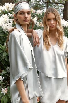 """Gorgeous @karolawarzecha and @liamariemielke hugged by 100% pure silk in our silver satin top """"Pieris"""" and """"Celine"""". Pieris is also available in matte black silk crepe only on nynolia.com"""