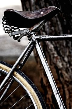 is it bizarre to want to hang a rusty old bicycle on the wall just for decration sake? cause if so- Im wierd.
