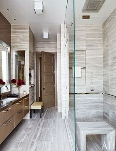 In a Manhattan penthouse, gray river stone lines the husband's bath.