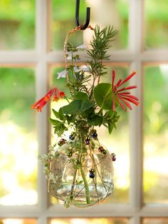 Tequila Bottle Turned Pretty Hanging Vase > Get the How To >> http://blog.diynetwork.com/maderemade/2014/05/15/turn-a-tequila-bottle-into-a-pretty-hanging-vase/?soc=pinterest